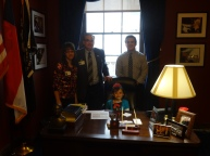 Sitting at Congressman Meadows desk.
