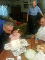 Blowing out candles for PopPop and Grandpa's Birthdays
