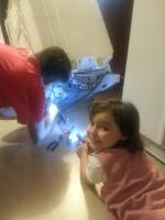Helping PopPop repair the dishwasher
