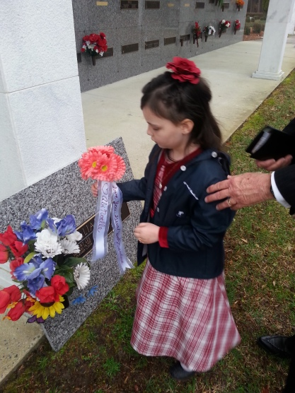 Placing flowers on Grandma's marker
